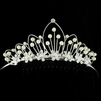 Inside sources report John has his eye on this very attractive pearl tiara