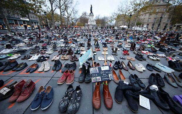 Climate change paris shoe protest