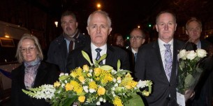 John Key with New Zealand's floral tribute in honour of the innocents slaughtered in Paris on 18 November