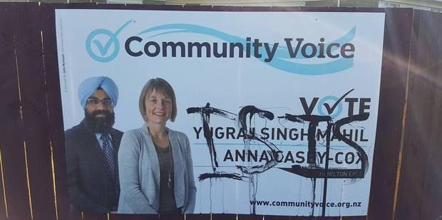 Community voice defaced billboard